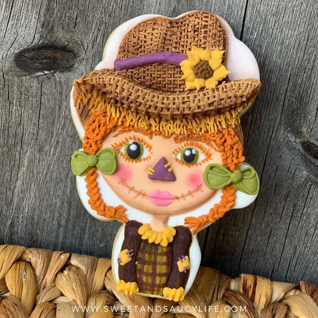 Scarecrow Girl Decorated Sugar Cookie with basketweave and sunflower techniques.